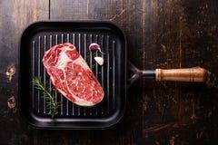 Raw Black Angus Steak ribeye on grill pan Stock Image