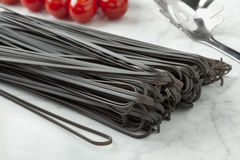 Raw black tinted spaghetti Stock Images
