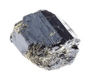 Raw black Tourmaline (Schorl) stone on white. Macro photography of natural mineral from geological collection - raw black Tourmaline (Schorl) stone on white royalty free stock photos