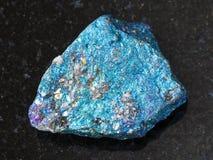 Raw blue Chalcopyrite stone on dark background Royalty Free Stock Images