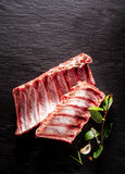 Raw Boar Spare Ribs with Fresh Herbs Stock Photos