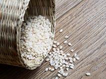 Raw bomba white rice. On wood background Stock Photos