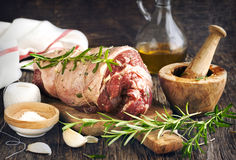 Raw boneless lamb leg with garlic and rosemary Royalty Free Stock Images