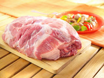 Raw boneless shoulder square cut on a wooden cutting board. Stock Photos