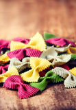 Raw Bow tie pasta  with variety of flavours - beetroot, herb, sp Stock Photo