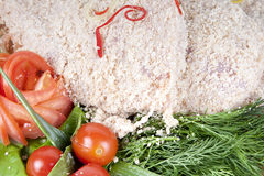Raw breaded meat cutlet. With vegetables Stock Image