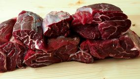 Raw breef meat. On wooden table stock video footage