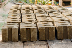 Raw bricks covered with sawdust drying in the open air. stock images