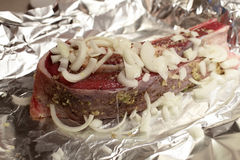 Raw brisket of beef with onions Stock Image