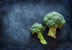 Raw broccoli on black chalkboard Royalty Free Stock Photography