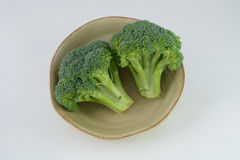 Raw broccoli in bowl Royalty Free Stock Images