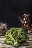 Raw broccoli. On dark wooden table Royalty Free Stock Photos
