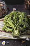 Raw broccoli. Over a dark wooden table Stock Photo