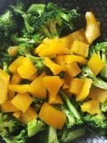 Raw broccoli and sweet pepper in a pan, ready to cook. Cooking at home, healthy and fun Royalty Free Stock Photos