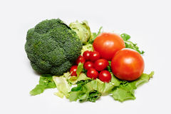 Raw broccoli, tomatoes. With green salad Stock Images