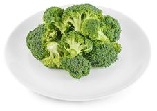 Raw broccoli vegetable on white plate isolated Royalty Free Stock Photo