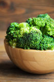 Raw broccoli on wooden table. Raw broccoli on wooden background, close-up. Selective focus Royalty Free Stock Image