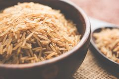 Raw brown basmati rice. Stock photo of Brown basmati rice in raw form, selective focus Stock Photos