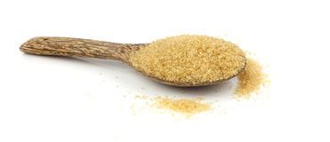 Raw brown cane sugar on white background Stock Image