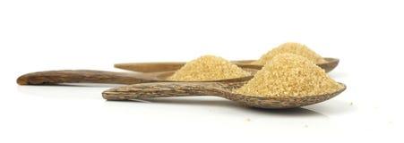 Raw brown cane sugar on white background Stock Photos