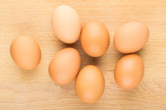 Raw brown chicken eggs on board, top view Stock Photos