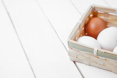 Raw brown chicken eggs on a wooden background. Stock Photos