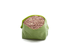 Raw brown rice. On white background Royalty Free Stock Images