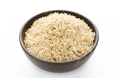 Raw brown rice in a bowl Stock Photo