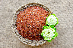 Raw brown rice and lotus flower in Basket weave Stock Photography