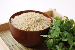 Raw brown rice in wooden bowl Royalty Free Stock Photos