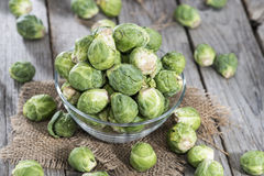 Raw Brussel Sprouts. Portion of raw Brussel Sprouts on vintage background Stock Photos