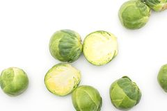 Raw Brussels sprout isolated. Raw Brussels sprout heads and two halves top view isolated on white background Royalty Free Stock Photography