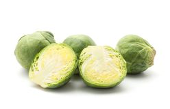 Raw Brussels sprout isolated. Raw Brussels sprout set isolated on white background three whole heads one cut in half Stock Photos