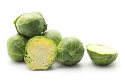 Raw Brussels sprout isolated. Raw Brussels sprout set isolated on white background whole heads and two sliced halves Stock Photo