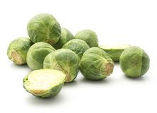 Raw Brussels sprout isolated. Raw Brussels sprout stack isolated on white background heads two sliced halves Royalty Free Stock Photos