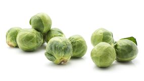 Raw Brussels sprout isolated. Raw Brussels sprout set isolated on white background a lot of fresh heads Stock Photo