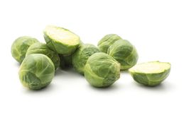 Raw Brussels sprout isolated. Raw Brussels sprout stack isolated on white background heads and two sliced halves Royalty Free Stock Photos
