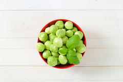 Raw Brussels sprouts. Bowl of raw Brussels sprouts on white background Royalty Free Stock Photo