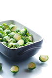 Raw Brussels sprouts in ceramic form Stock Photos