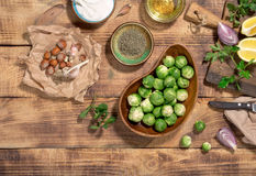 Raw brussels sprouts with different ingredients for cooking heal. Healthy food. Raw brussels sprouts with different ingredients for cooking healthy food, top Royalty Free Stock Photo