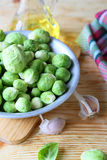 Raw Brussels sprouts, ingredients Stock Photos
