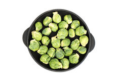 Raw brussels sprouts in pan Stock Photo