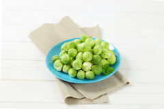 Raw Brussels sprouts. Plate of raw Brussels sprouts on beige place mat Royalty Free Stock Photography