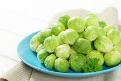 Raw Brussels sprouts. Plate of raw Brussels sprouts - close up Stock Photos