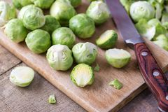 Raw brussels sprouts on wooden cutting desk. Royalty Free Stock Images
