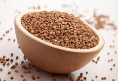Raw buckwheat  in bowl Stock Photography