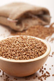 Raw buckwheat in bowl Royalty Free Stock Photos