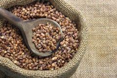 Raw buckwheat. In canvas sack royalty free stock photos