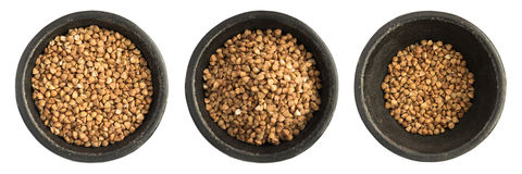 Raw Buckwheat Grains Heap in Black Iron Bowl Stock Image