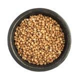 Raw Buckwheat Grains Heap in Black Iron Bowl Stock Photography